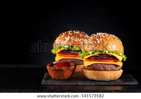 Beef burgers cheeseburgers on a black chalkboard
