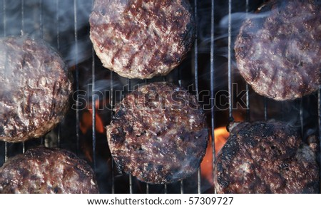 beef burgers cooking on a BBQ - stock photo