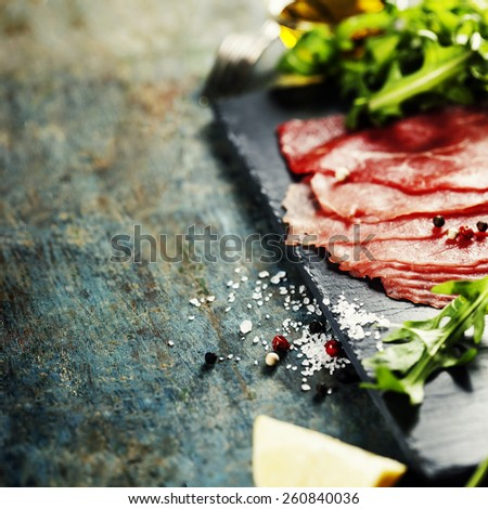 Beef Carpaccio on dark background - stock photo