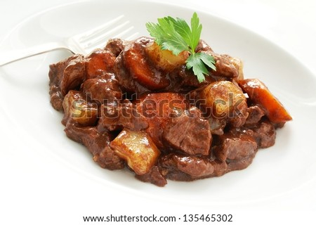 beef casserole on white plate - stock photo