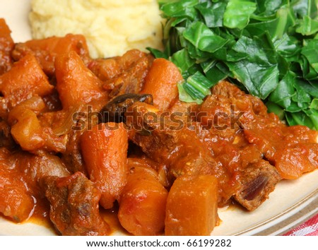 Beef casserole with mashed potato and spring green cabbage.