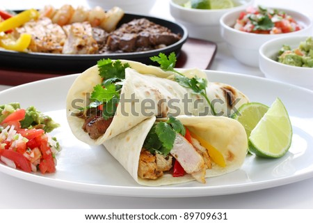 beef chicken and shrimp fajitas, mexican cuisine, tex-mex cuisine - stock photo