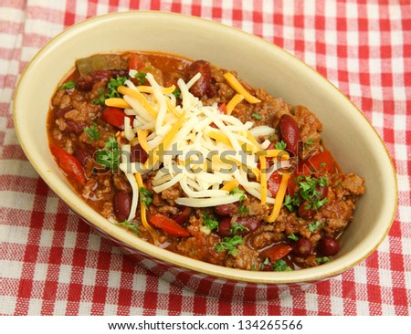 Beef chili with grated cheese - stock photo