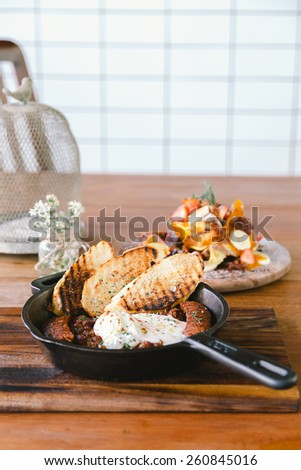 Beef Chili with poached egg and homemade chorizo,vertical  - stock photo
