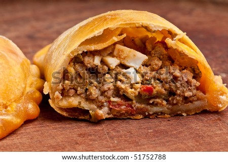 Beef Empanada fill close up.  The Empanada is a pastry turnover filled with a variety of savory ingredients and baked or fried. - stock photo
