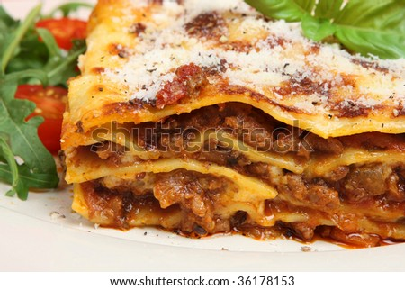 Beef lasagna topped with Parmesan cheese - stock photo