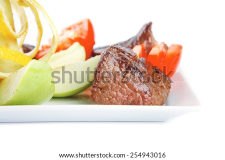 beef meat served on dish with vegetables - stock photo