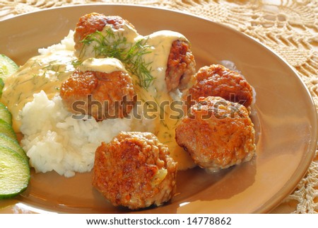 Beef meatballs with white dill sauce served on rice - stock photo