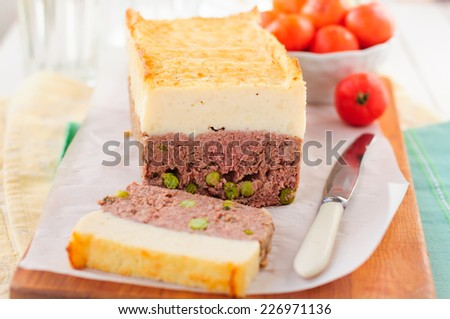 Beef Meatloaf with Green Peas Topped with Cheesy Mashed Potato, copy space for your text - stock photo