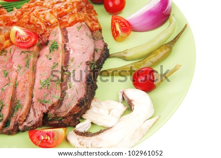 beef on plate with peppers isolated over white