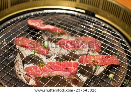 Beef on the Korean BBQ grill - stock photo