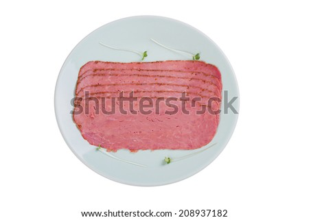 Beef Pastrami on a Blue Plate Isolated on a White Background - stock photo