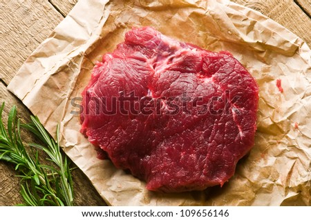beef piece on wood board closeup - stock photo