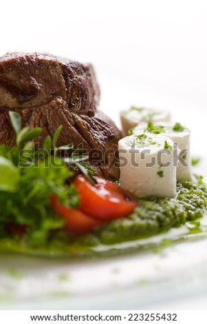 Beef roasted on green sauce with fresh cheese Beef roasted on green sauce with fresh cheese