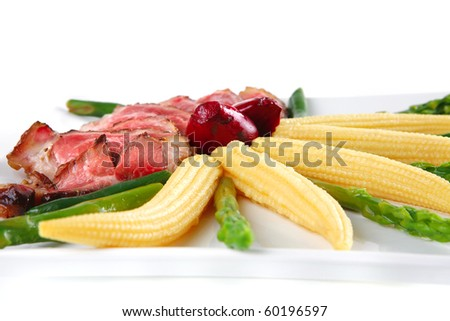 beef served with beans and corns on white dish