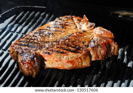 Beef steak grilled on a bbq, florentine t-bone beef steak. Tuscan cuisine, Italy - stock photo