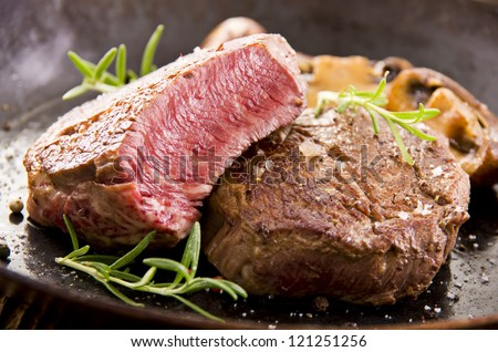 beef steak in the pan - stock photo