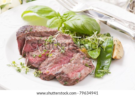 beef steak medium with vegetables