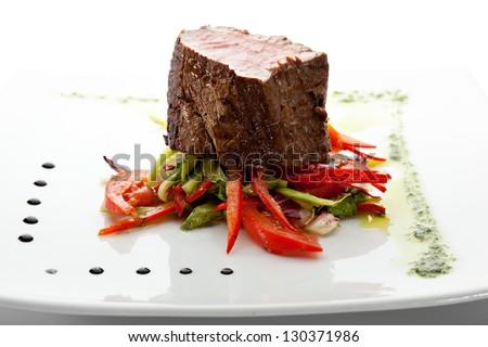 Beef Steak on Fresh Salad Leaf with Pesto Sauce - stock photo