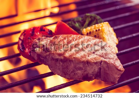 Beef steak on the grill with vegetable.
