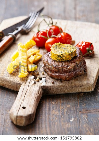 Beef Steak with Butter and Baked tomato - stock photo