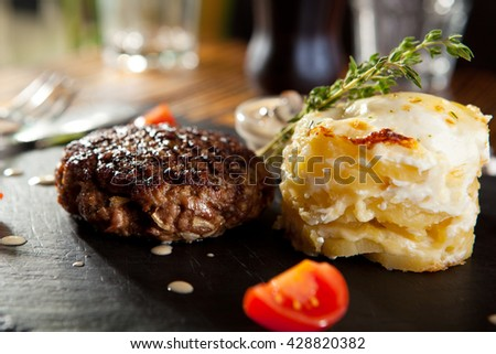 Beef Steak with Mashed Potato and Mushrooms Sauce - stock photo