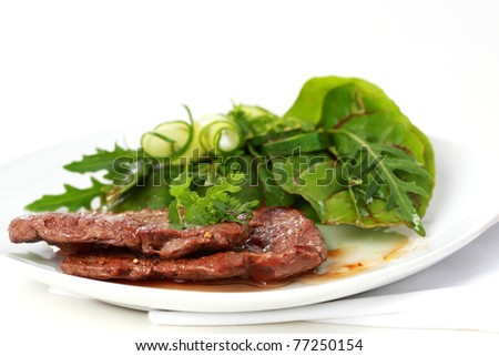 Beef steak with mixed green salad
