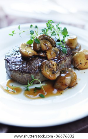 beef steak with mushrooms - stock photo