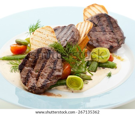 Beef Steak with Vegetables and Potatoes Chips