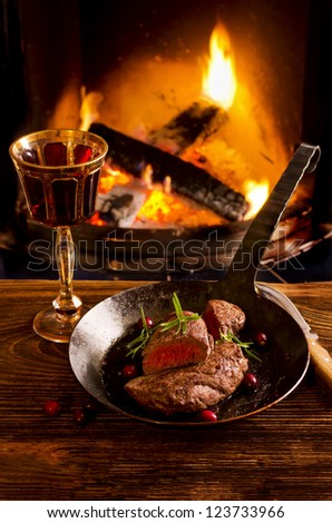 beef steaks in the pan - stock photo