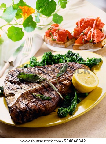 Beef steaks with grilled vegetables and seasoning.