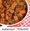 Beef stew in casserole dish - stock photo