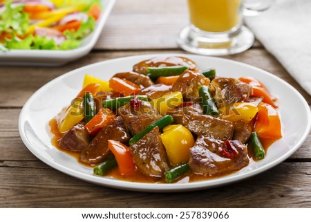 beef stew with peppers and green beans - stock photo