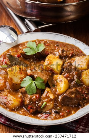 Beef stew with potatoes in a plate - stock photo