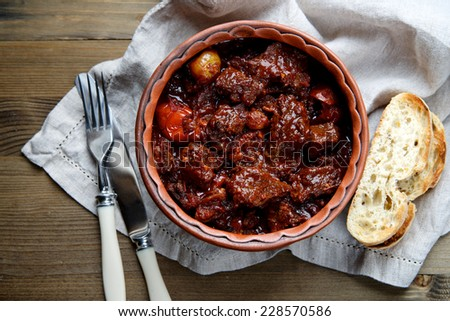 Beef stew with vegetables in a ceramic bowl - stock photo