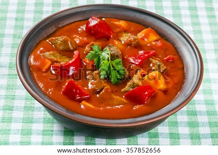Beef stew with vegetables or goulash, traditional hungarian meal, closeup - stock photo