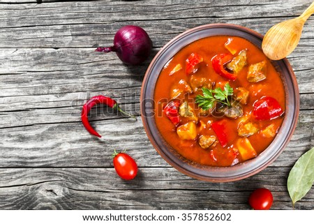 Beef stew with vegetables or goulash, traditional hungarian meal, top view - stock photo