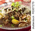 Beef stroganoff with small potatoes and sauce - stock photo