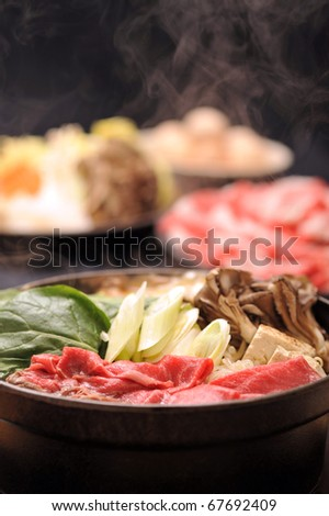 Beef Sukiyaki , Japanese Food with steam 2 - stock photo