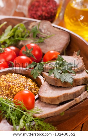 Beef tongue on plate still-life