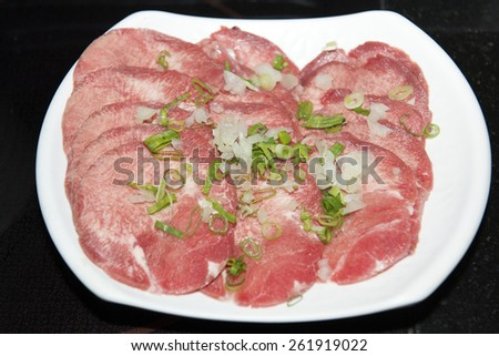 Beef tongue sliced on white dish - stock photo