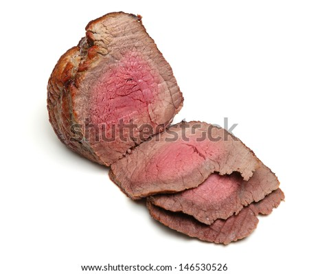 Beef topside joint roasted to medium rare. - stock photo