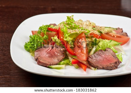 beef with fresh vegetable - tasty salad - stock photo