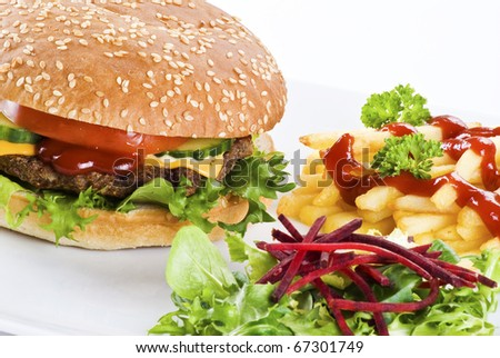Beefburger with crispy salad leaves and chips - stock photo