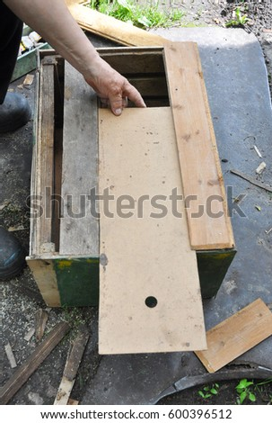 Beekeeper Building Wooden Trap For Wild Bees Or Swarming Honey