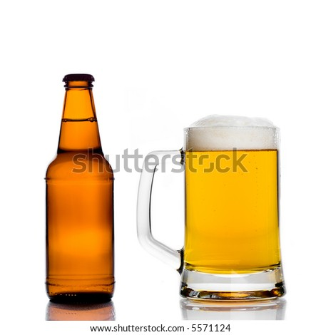 Beer bottle and a mug isolated on white