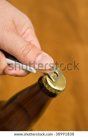Beer bottle being open - stock photo