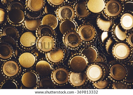 Beer bottle caps heap, unbranded metallic caps as pattern background. - stock photo