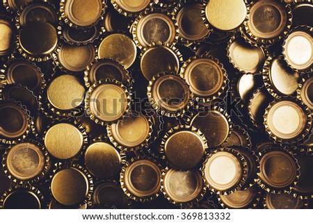 Beer bottle caps piled - stock photo