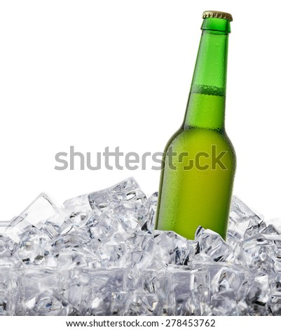 beer bottle getting cool in ice cubes. Isolated on a white background.